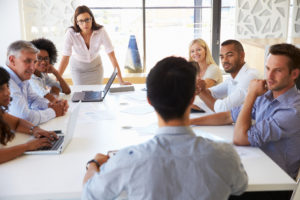 Business meeting where woman is presenting to colleagues